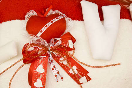 red heart on white ribbon