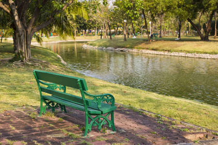 green seat in the park in Thailand Stock Photo