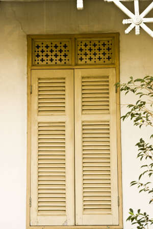 thai style windows of old wooden house