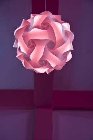 pink lighting hanging on ceiling