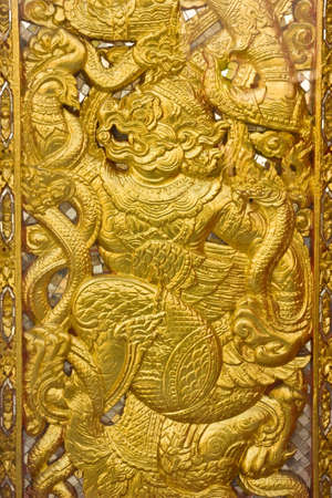 engrave by hard wood on mural in Thai temple Stock Photo
