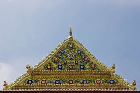 pattern by Thai style on top of ancient Buddha church Stock Photo