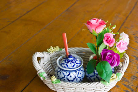 condiment set and beauty flowers in basket