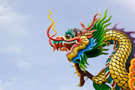 dragon head by Chinese style under blue sky photo