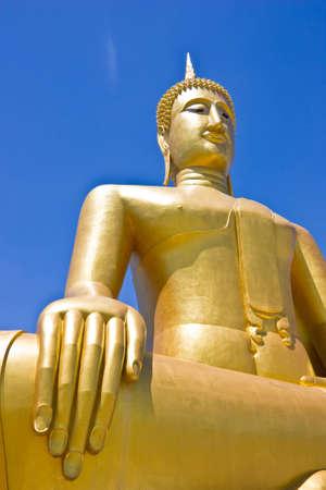 gold Buddha image by blue sky
