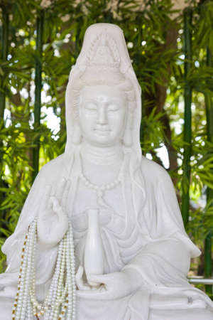 country side: white maeble goddess of mercy image