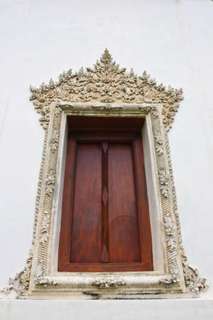 antique windows at Buddha church ni Thailand Stock Photo - 11020989