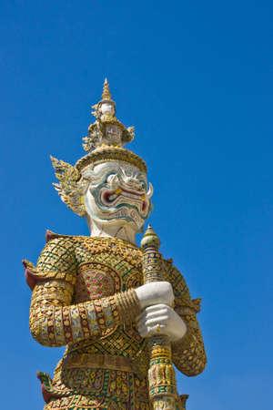white giant image around the temple of emerald Buddha Bangkok Thailand Stock Photo
