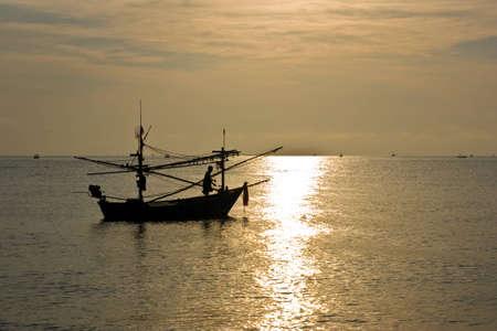 sea people and fishing boat Stock Photo