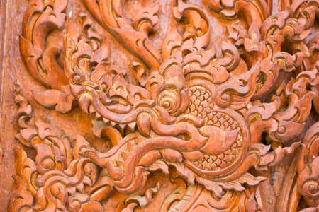 engraving by teak wood Stock Photo - 14255642