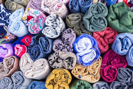 Colorful cotton fabric and textiles on the market for industry, fashion, furniture and interior concept design.