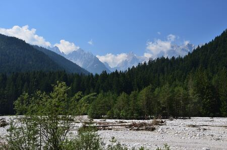 The bed of the Ansiei river, surrounded by woods and mountains