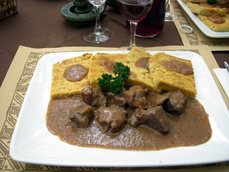 A good dish of meat with polenta of Storo