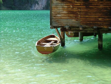 Boat in the Lake Braies, suspended on the water