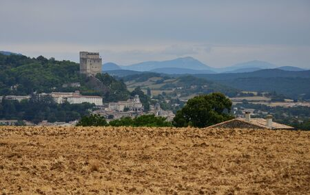 From the small hill the ancient tower dominates and controls the valley