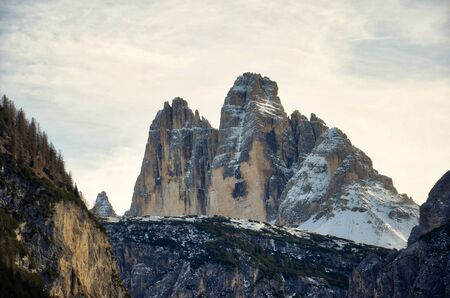 View of the Tre Cime di Lavaredo framed by the surrounding mountains. HDR image