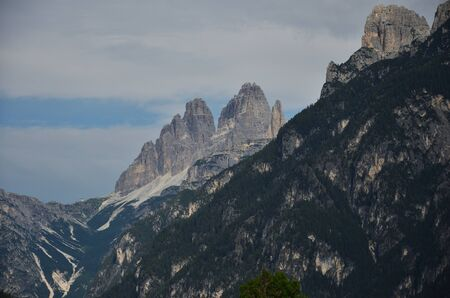 In a summer afternoon the peaks of Lavaredo stand out against the cloudy sky