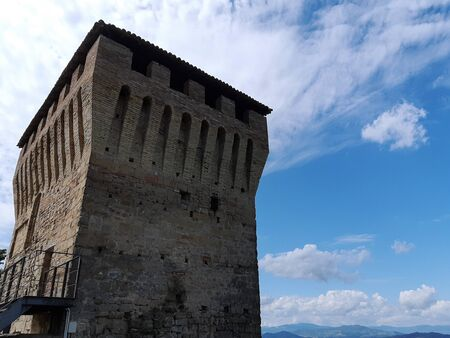 The tower of Sarzano castle silhouetted against the sky