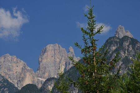 Dolomitic peaks in the blue sky on a summer day