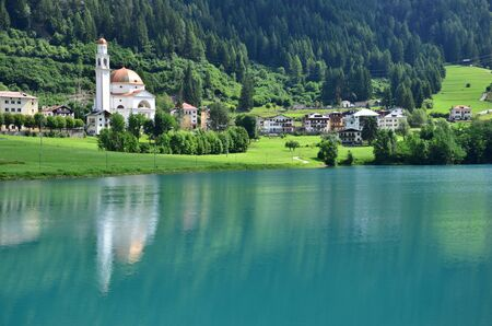 The church is reflected in the tranquil waters of Lake Auronzo