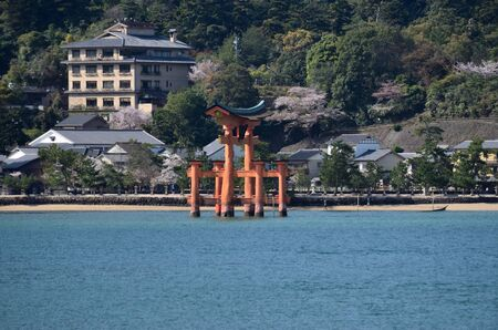 The ocean waters surround the torii red