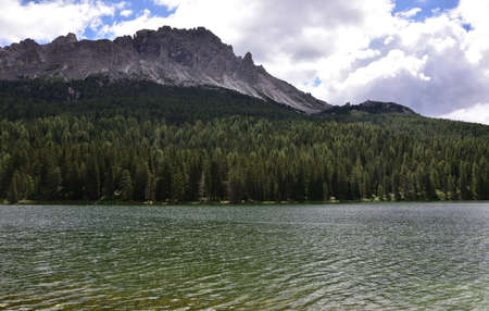Vast forests on the shore of Lake Misurina with the Cadini group in the background and the Col de Varda on the right Stock Photo