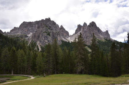 From the small lake of Antorno, not far from the town of Misurina, a look at the nearby peaks of a group of Cadini Stock Photo