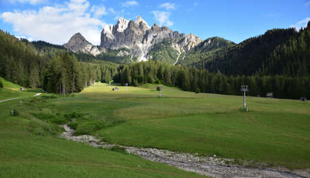 Green meadows in Alt Pragser Tal with Picco Vallandro in the background