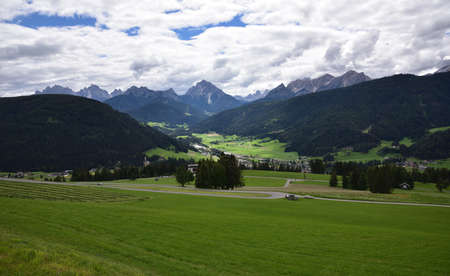 From the top of the town of Tesido, view of the Val Pusteria with the town of Monguelfo and the nearby Dolomite peaks