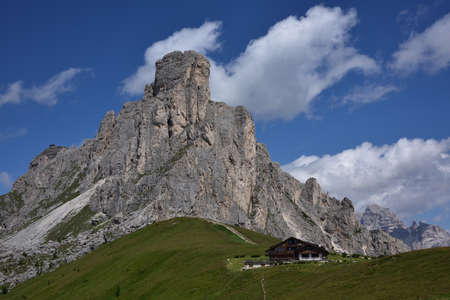 The rocks of Ra Gusela, at Giau pass, with the Nuvolau refuge on the left Stock Photo