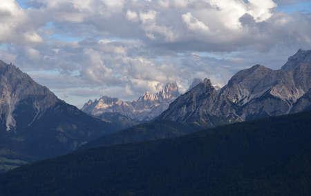 The Cristallo group with Piz Popena framed between Picco Vallandro, Monte Pollice and Sasso del Signore