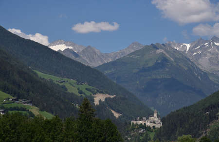 The castle of Campo Tures in the background of the mountains of the Aurina valley
