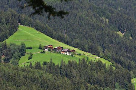 Farms and barns on the mountain coast