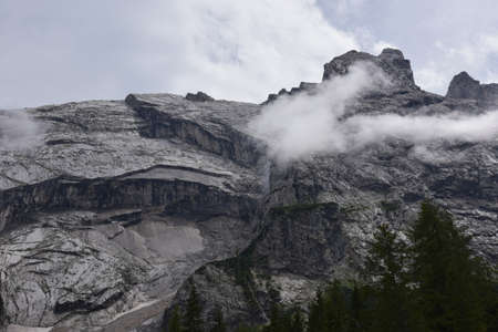 Slabs of gray rock wet with rain on the mountains of Val d'Oten