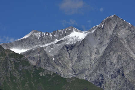 A small summer snow has whitened the peaks of the Croda Nera