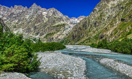 The waters of the Torrent de Saint Pierre in the vicinity of the Pre de Madame Carle located in the commune of Vallouise, within the national park des Ecrin, Hautes Alpes department, France. HDR image