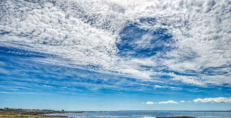 Bizarre clouds in the sky of the Cote Sauvage in the Quiberon peninsula, Morbihan region in Brittany, France. HDR image Stock Photo