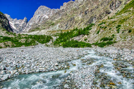 The waters of the Torrent de Saint Pierre in the vicinity of the Pre de Madame Carle located in the commune of Vallouise, within the national park des Ecrins, Hautes Alpes department, France. HDR image Stock Photo