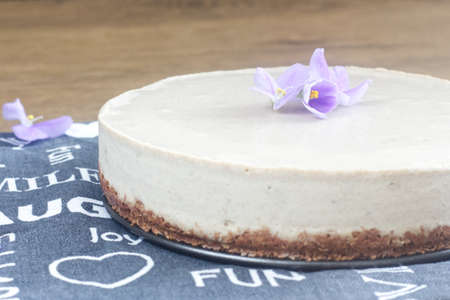 Photo of homemade vegan raw food cake made from coconut fat.