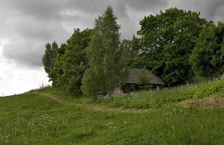 abandoned farmhouse abandoned farmhouse: An abandoned farmhouse on a hillside