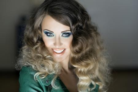 young brunette smiling woman, studio shot