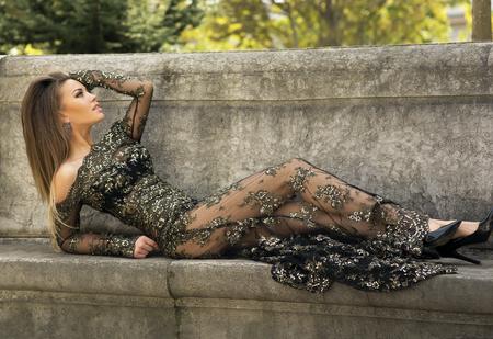 Elegant beautiful brunette woman posing wearing beautiful dress.  photo