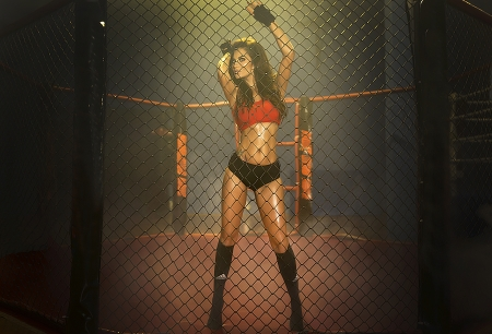 boxers: Young pretty boxer woman standing on ring, posing