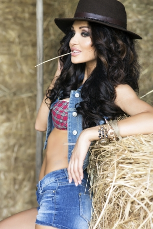 Young sexy Woman wearing cowboy hat, posing. Stock Photo - 24611492