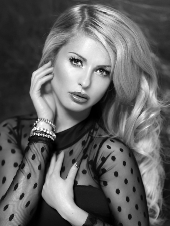 Elegant photo of sensual blonde woman portrait. Girl looking at camera.