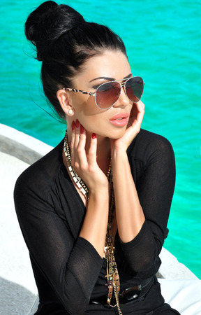 Portrait of sensual brunette young woman on vacation day.