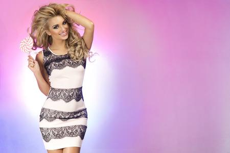 Happy beautiful smiling blonde woman posing in studio