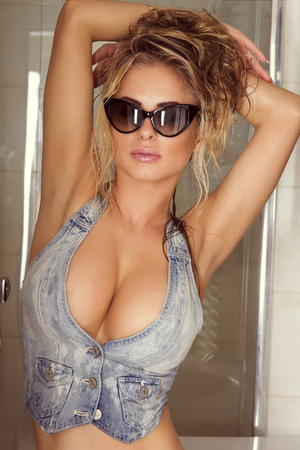 Portrait of sexy blonde woman wearing sunglasses. photo