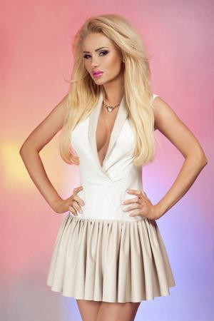 Elegant beautiful blonde woman posing in studio, girl with perfect makeup.