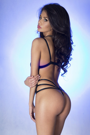 blue lingerie: Sensual photo of sexy brunette beautiful woman posing in lingerie. Perfect body